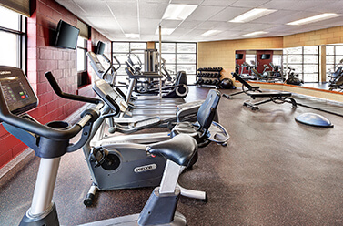Gym and fitness facility at hotel.